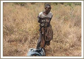The arrested poacher with his bow and arrows