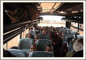 Students aboard the bus during their field trip