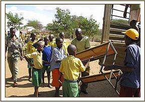 Students help to offload the desks