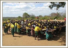 Pupils sitting at their newly donated desks