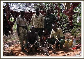 The Mtito team with the poacher and his bushmeat