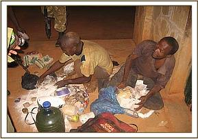 The two arrested poachers and their wares