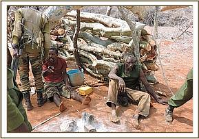 Arrested poachers with their snares