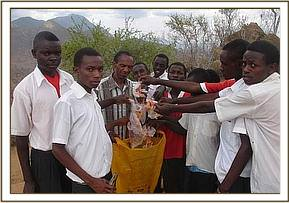 Nguumo pupils collecting litter in the park