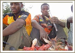 Arrested poachers with their bushmeat