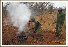 Team destroying a charcoal kiln in Mangelete