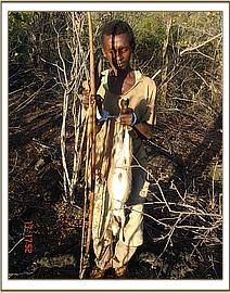 Another bushmeat poacher with bows & arrows