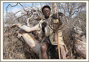 Arrested poacher with his bow & arrorw &*snares