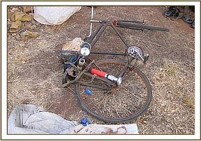Bicycle & lamping torch belonging to the poachers