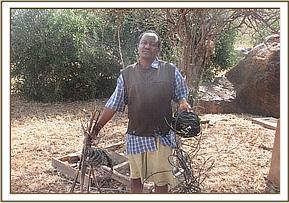 The second arrested poacher displays his snares