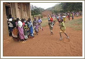 Community members running to the video show room