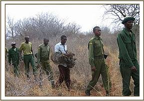 Poacher, Rangers & our team with bushbuck remains
