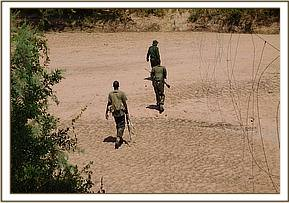 TEAM ON PATROL CROSSING TIVA RIVER AT KASAALA ARE