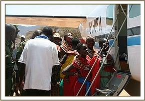 The locals come to look at the ophan in the rescue plane