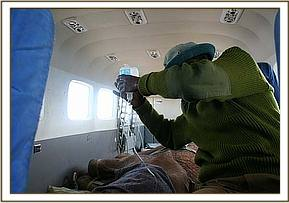 The orphan is put on an emergency drip on the plane