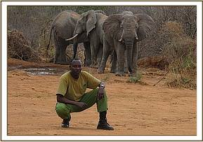 Zoom Zoom, a Nairobi Nursery Keeper who accompanied Salaita on the flight enjoys the wild orphans at the Ithumba stockades