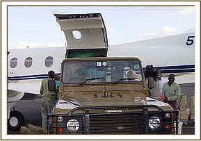 The landrover parks close to the PC 12 aircraft so that Madiba's crate could be manoeuvred off the plane