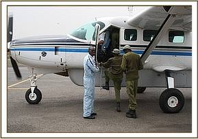 The Keepers board the rescue plane