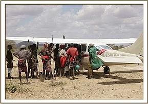 The calf attracted great interest from the Namunyak community seen here all looking at the calf loaded into the plane
