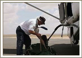 The pilot prepares the rescue stretcher matress and straps for the flight.jpg