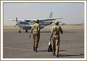 The elephant Keepers going on Kibo's rescue walk across the apron on the airfield to the waiting plane to fly them to Amboseli.jpg