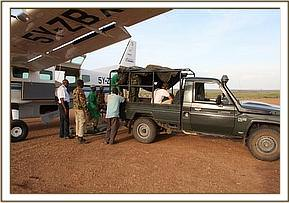 Laragai is brought to the airstrip at Borana