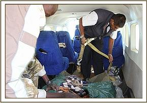 Everyone helps load the orphan in the plane
