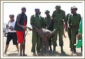 Kimana at the airstrip with those involved in his resuce