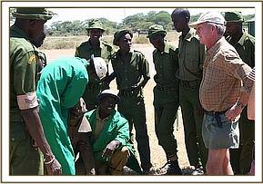 Richard Boham, KWS rangers, DSWT Keepers and the rescued calf.