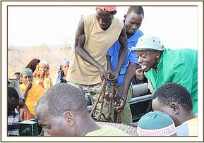 The Keepers & Community members lift the heavy calf out the vehicle and into the rescue plane