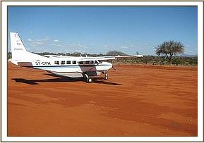 The plane arrives on the Voi Airstrip to collect Chyulu