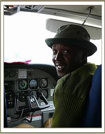 Stephen in the front seat of the plane en route to the Mara.jpg