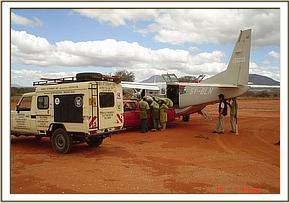 The orphan is loaded onto the plane to be brought to the Nairobi Nursery Unit