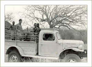 David Sheldrick in the back of the lorry having just rescued Sampson 1954
