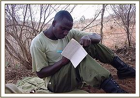 A keeper recording events in the bush