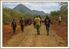 Search team returning with the orphans