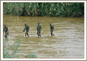 Following poachers,across the river Athi