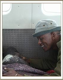 Abdi with the little elephant on the plane