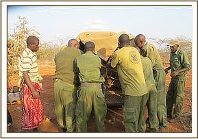 Loading the orphan in the vehicle to transport her to Voi