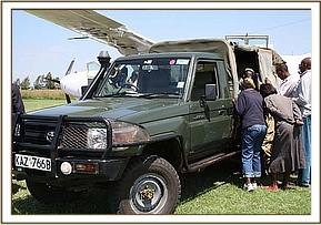 The KWS vehicle waits for the rescue plane on the airstrip.jpg