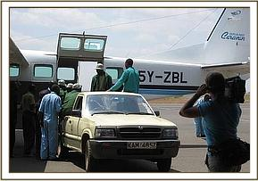 Lenana is taken off the aircraft and loaded into the waiting Trust pickup